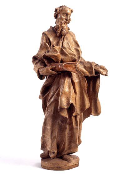 Statuette des Apostels Petrus in stoffreicher Gewandung,  in der Rechten ein Buch.