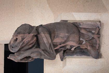 Münsterbauhütte, Freiburg Gargoyle: Man dressed in a belted surcoat