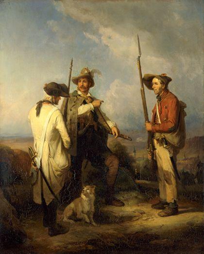 Drei Männer mit Gewehren stehen auf einem Feld. Zwischen ihnen sitzt ein Hund, im Hintergrund ist ein Kirchturm erkennbar.