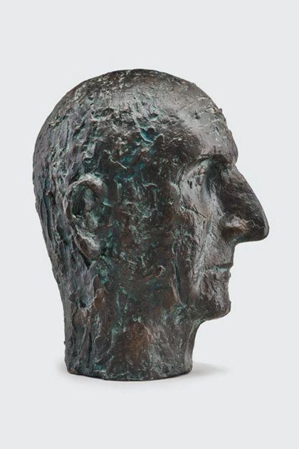 Bronzekopf eines alten Mannes mit zerfurchter Stirn und großer Nase, Seitenansicht nach rechts