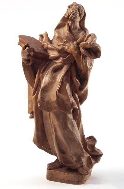 Statuette des Apostels Paulus in stoffreicher Gewandung, in der Rechten ein Buch.
