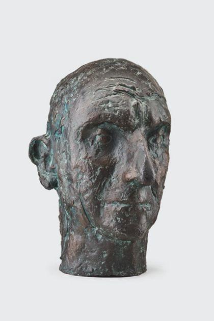 Bronzekopf eines alten Mannes mit zerfurchter Stirn
