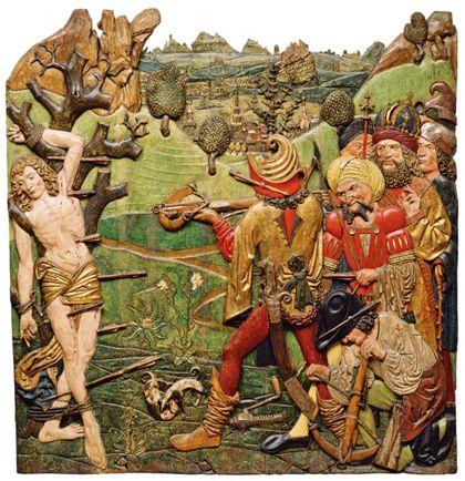 Das Reliefs zeigt vor einem Landschaftsgrund das Pfeilmartyrium des heiligen Sebastian. Vorne links ist der Jüngling an einen kahlen Baum gefesselt, ihm gegenüber die detailreich dargestellte Gruppe der Schützen.